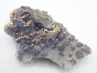 Calcite ferrifère sur Fluorite violacée, mine de Fontsante, Var.