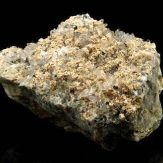 Rhodochrosite et chalcopyrite sur quartz du Pérou.